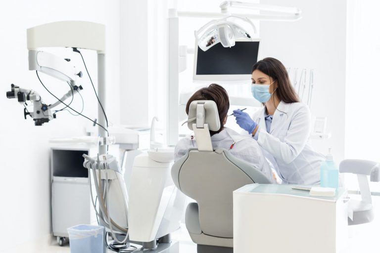 Dentist doctor treating patient in dental clinic
