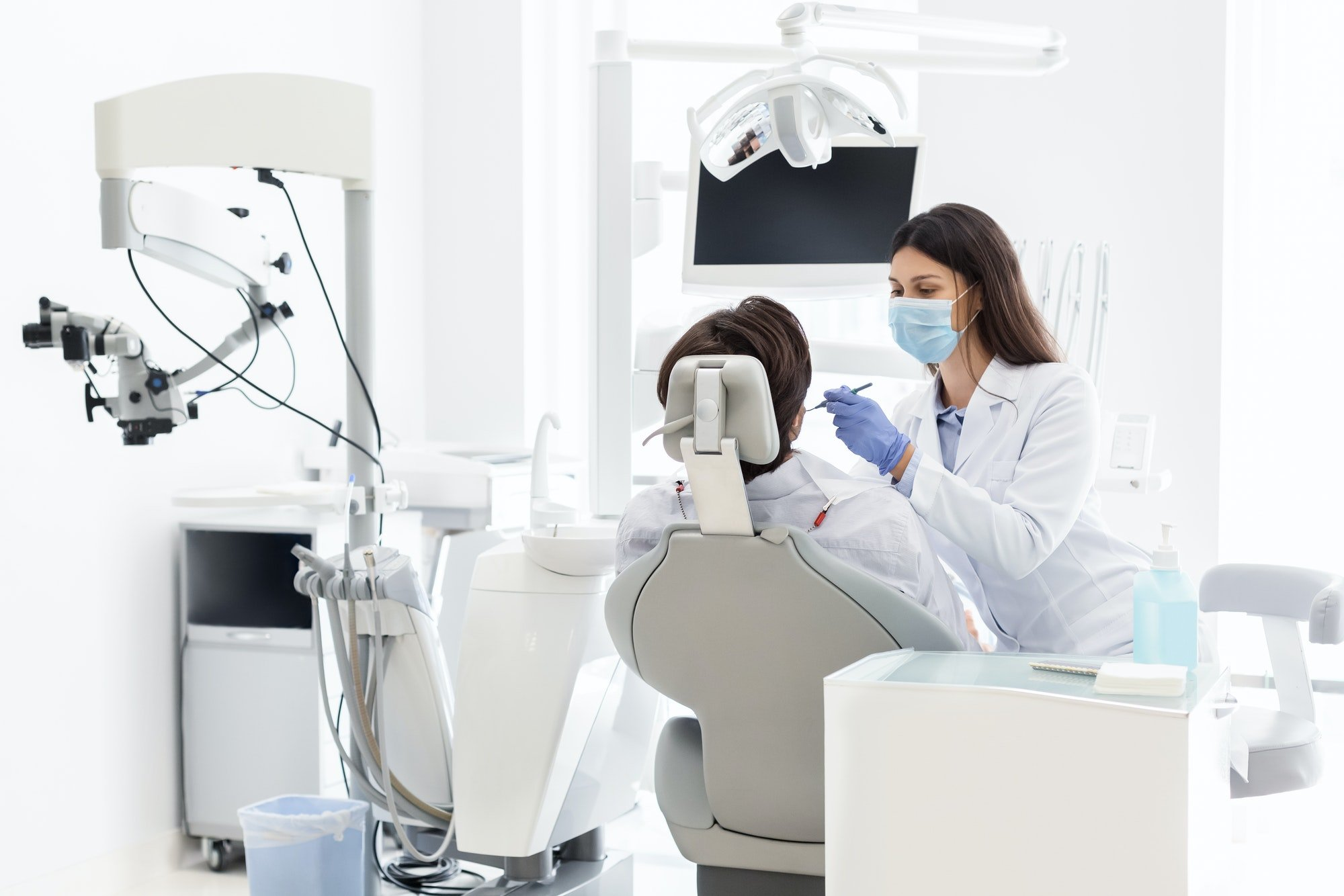 pretty-dentist-doctor-treating-patient-in-dental-clinic.jpg